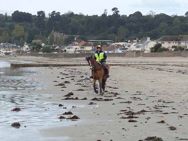 Horse rider on the sands, St Aubin's Bay