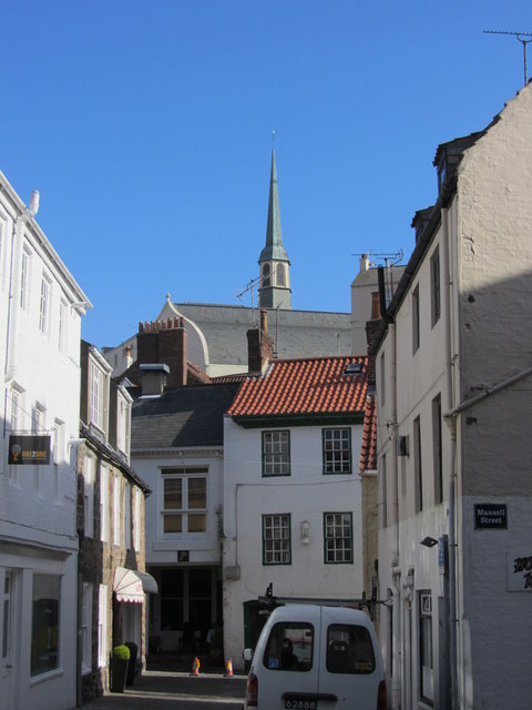 Side road off Mansell Street & view to spire of  Notre Dame Church, St Peter Port
