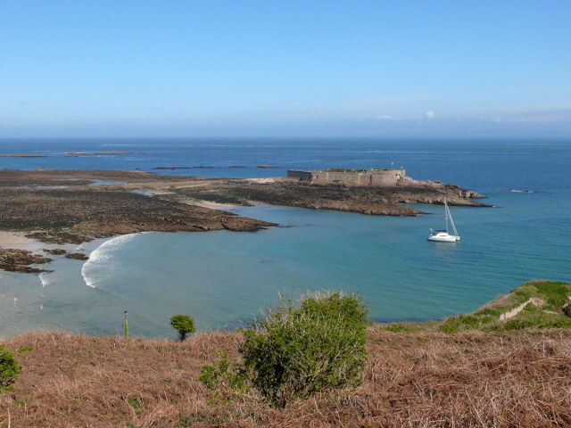 Longis Bay and Fort Raz at low tide