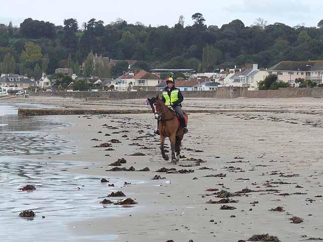 Horse rider on the sands, St Aubin's Bay